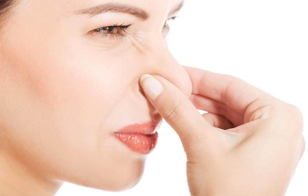 Woman pinching nose