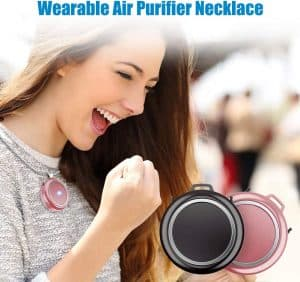 Woman wearing a personal air purifier.