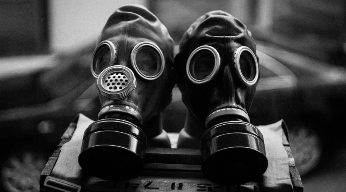 Two black gas masks side by side.